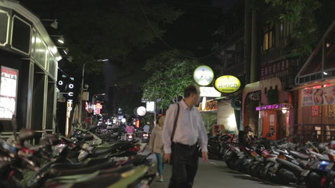 Night - Taipei street wih scooters and restaurants Footage