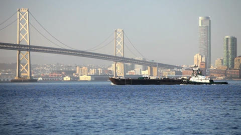 Tugboat at Bay Bridge Stock Video Footage