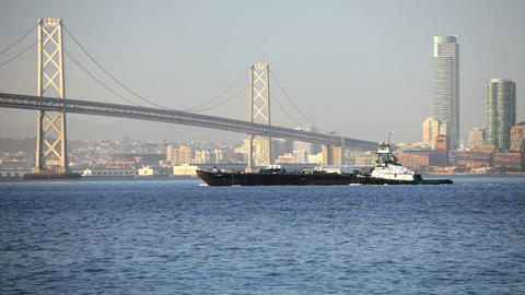 Tugboat at Bay Bridge Stock Video Footage