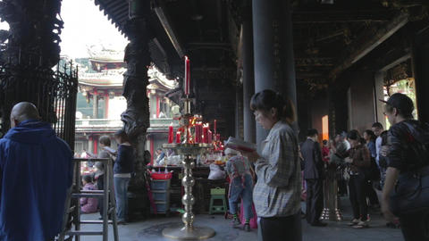 Longshan Temple - people chanting candles - dolly  Footage