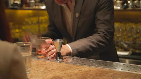 Upscale Bartender In Suit Mixes A Drink stock footage