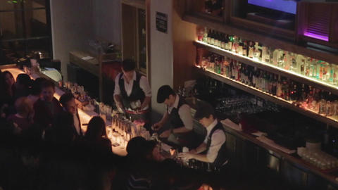 Birds eye - dolly shot of bar area and people enjo Live Action