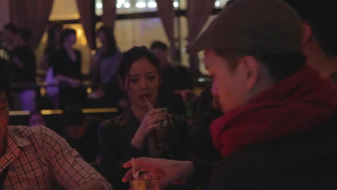 Trendy Asian Group Enjoying A Drink At Lounge stock footage