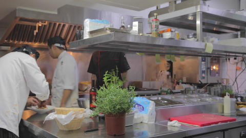 Dolly Shot - Restaurant Kitchen - Asian Cooks stock footage