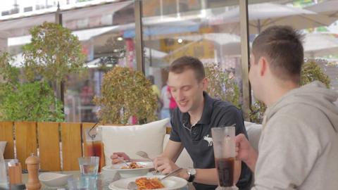 2 Friends Enjoying A Casual Lunch stock footage