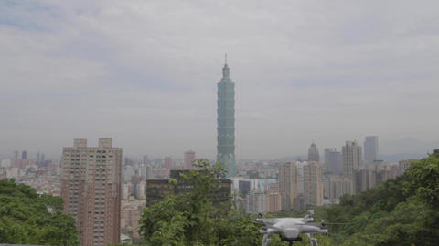 tilt shot - drone with Taipei 101 in the backgroun Live Action