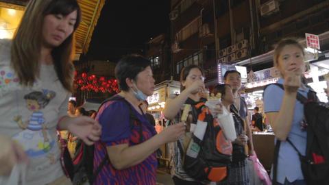 family eating snacks - Raohe night market Live Action