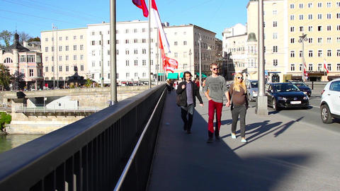 People And Traffic Crossing River Salzach stock footage
