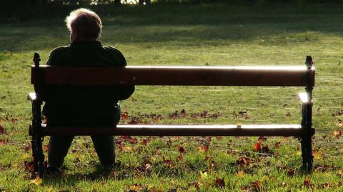 4K Elder Women Sitting on a Bench in Autumn Park 2 Footage