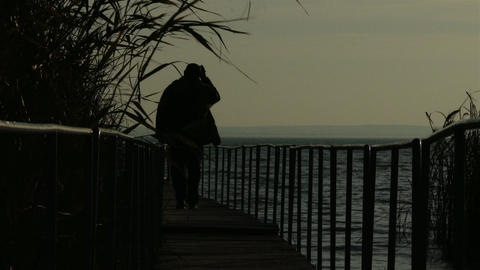 4K Mature Man Walking on Pier in Autumn Sunset 3 Footage