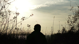 Mature Man Looking Around On Autumn Lakeside 1 stock footage
