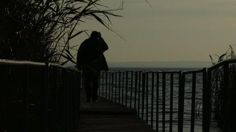 Mature Man Walking on Pier in Autumn Sunset 3 Footage