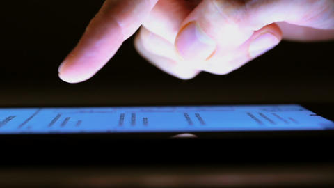 Closeup of person using tablet computer touchscree Footage