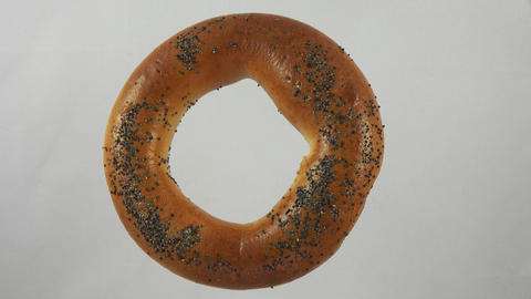 Bagel with poppy seeds. 4K Footage