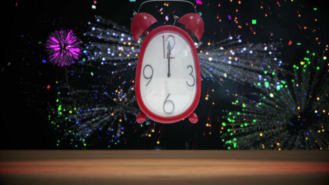Cute alarm clock counting to midnight with confetti and fireworks Animation