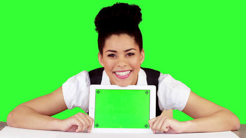 Pretty woman showing tablet with green screen Animation