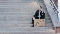 Businessman Sits On Steps Economic Arrow Live Action