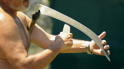 Sharpening Scythe In Hot Summer Day stock footage