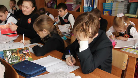 Pupil at the school sits daydreaming in class Footage