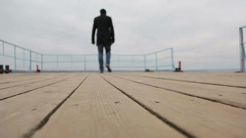 Sad Pensive Man Walks On The Pier stock footage