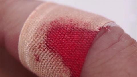 Bloody Bandaged Finger Macro stock footage