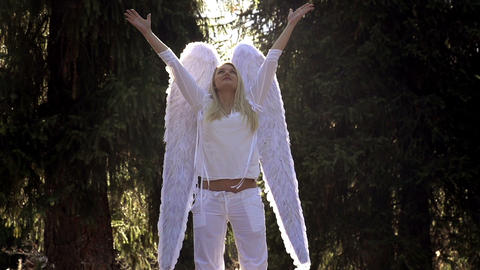 Girl in White with Angel Wings Footage