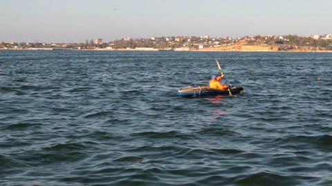 Man paddling a kayak Footage
