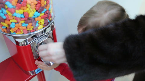 Girl gets candy from machine sale of sweets Footage