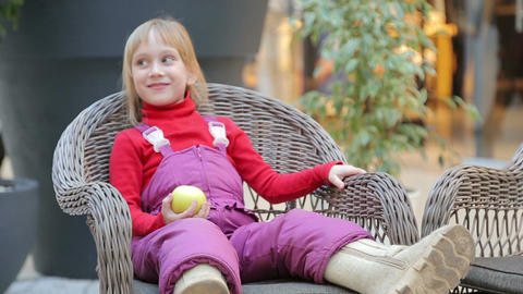 Girl Sitting On A Chair Made Of Twigs stock footage