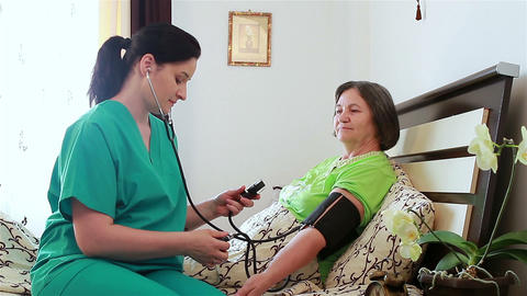 Blood Pressure Check To Senior Woman stock footage