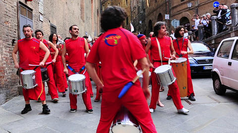 Locked-on shot of a musical band, Siena, Tuscany,  Footage