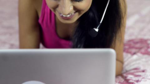 Tilt up shot of a woman using a laptop Footage
