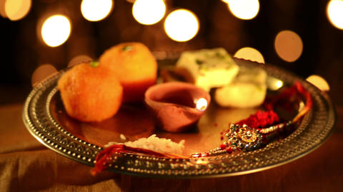 Locked-on Shot Of A Spinning Puja Thali With Rakhi stock footage