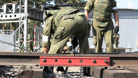 Armed soldiers are fixing railroad Footage