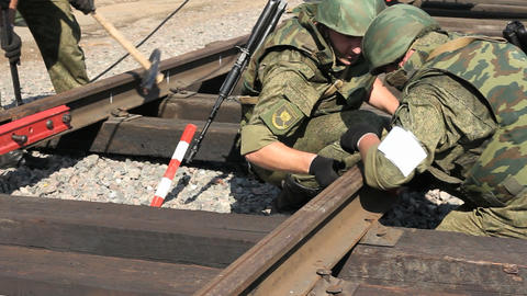 Soldiers are connecting railroads. Close Up Footage