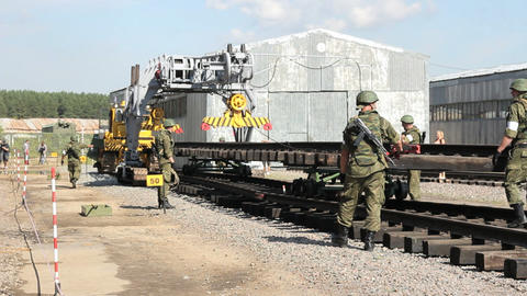 Soldiers Build Railway. Warehouse In Background stock footage