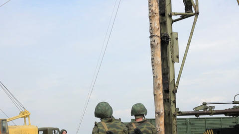 Russian Soldiers work with Pile Driver Footage