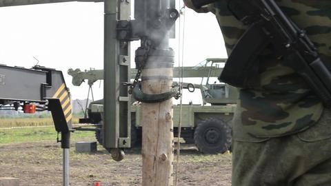 Soldier. Ak-47. Pile driver Footage