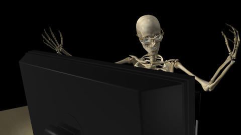Skeleton At Computer - Close Front - Loop - Alpha stock footage