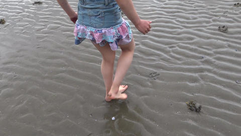 Girl Walking By Wet Beach Sand stock footage