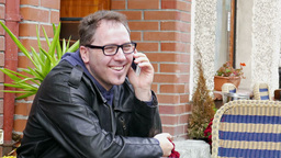 Happy man in glasses is talks on a mobile phone Footage