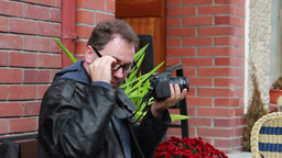 Detective, secret agent or paparazzi in action Stock Video Footage