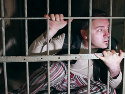 Strongly frightened man behind bars Footage