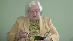 Old, catholic woman praying the rosary Live Action