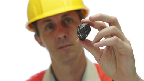 Miner Inspects Carbon Graphite Ore Live Action