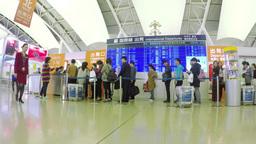 Timelapse video of travellers entering the departu Footage