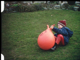 Boy hopping on ball (vintage 8mm-film) Footage