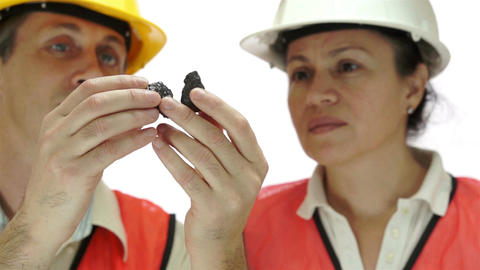 Miners Inspecting Carbon Graphite Ore Live Action