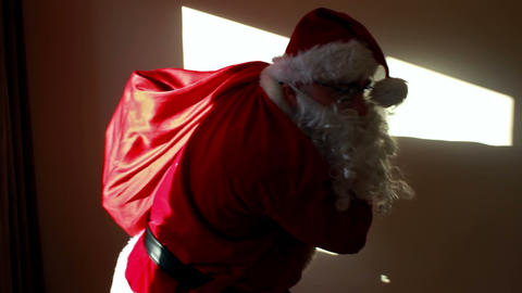 Santa Claus with a huge bag entering Footage