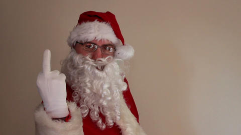 Rude Santa Claus Shows His Middle Finger stock footage